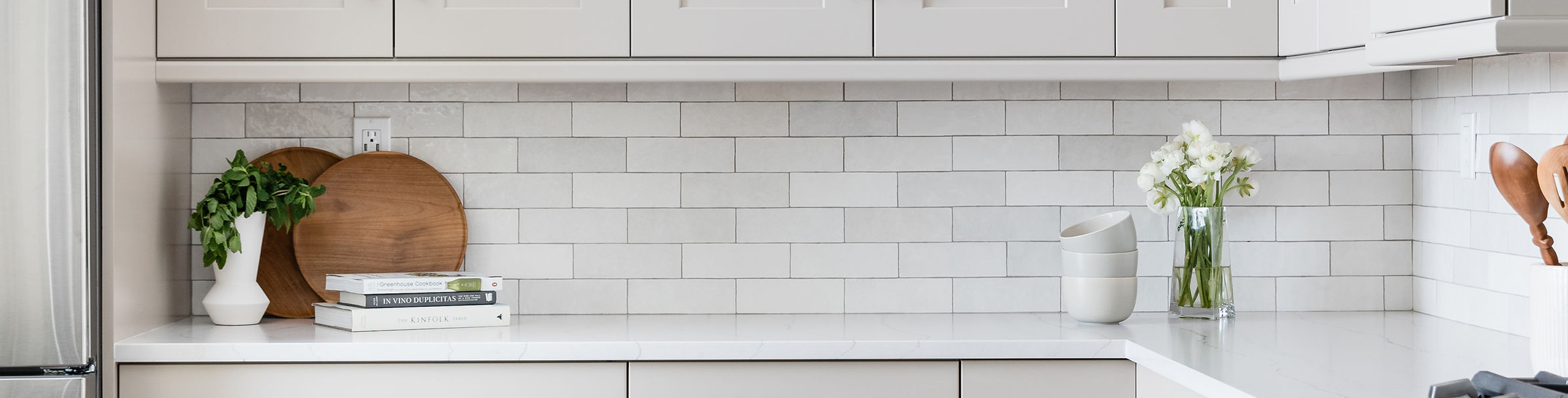 Cloé Ceramic Tile in White with dark grout - designer: Precision Cabinetry & Design, photo: Stephanie Russo