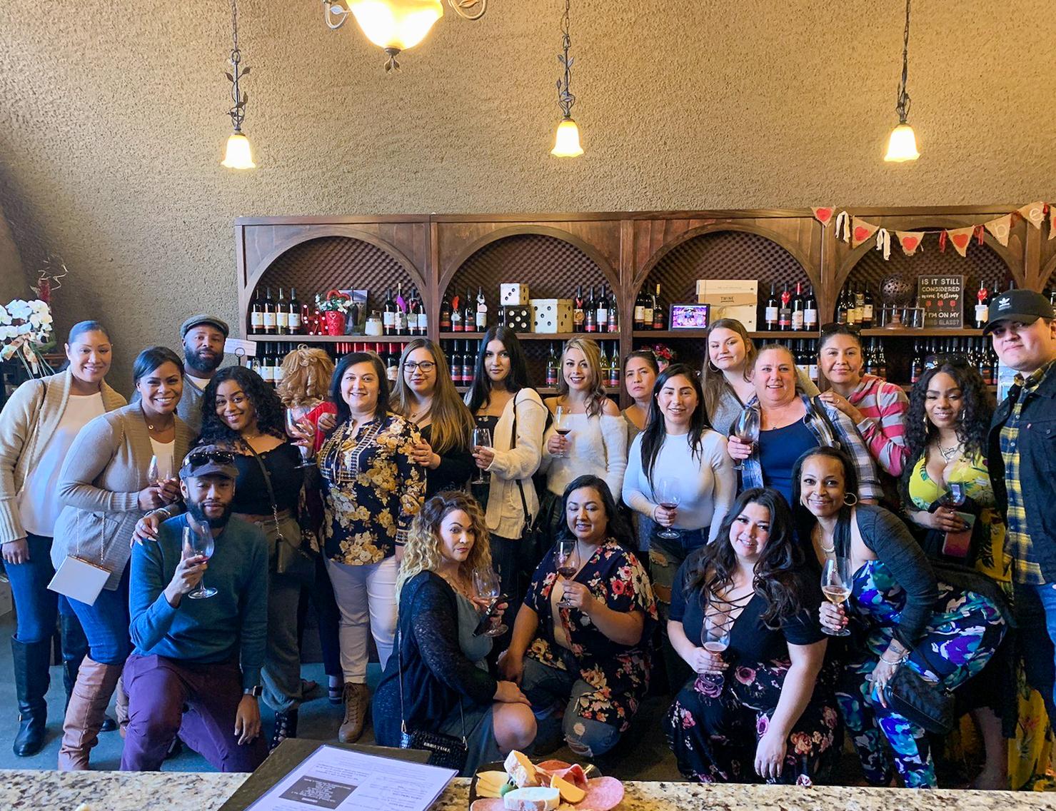 Group posing at winery