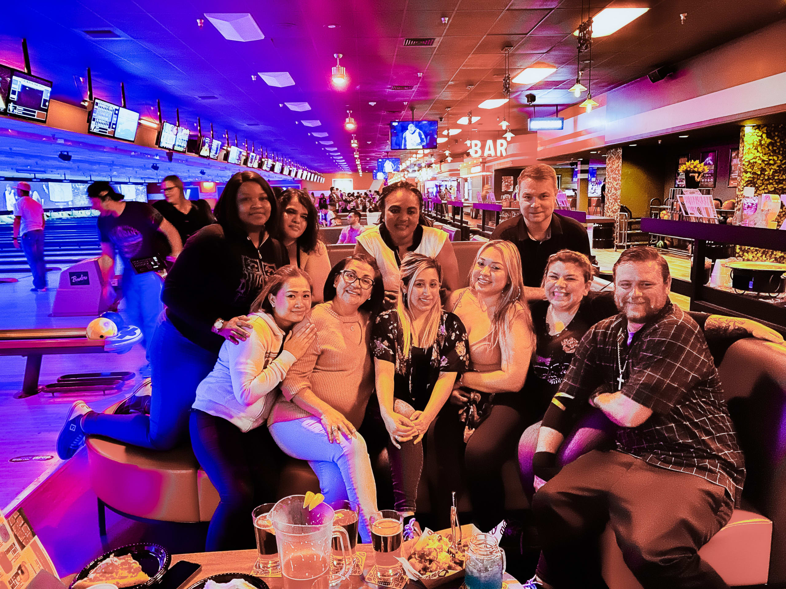people posing at a bowling alley