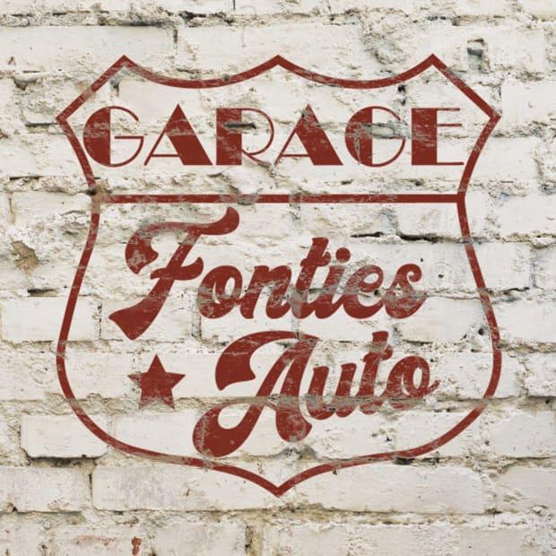 logo du garage Fontiès Auto sur un mur en brique
