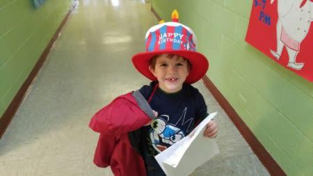 Preschool boy smiling in hallway at Bethel United Methodist.