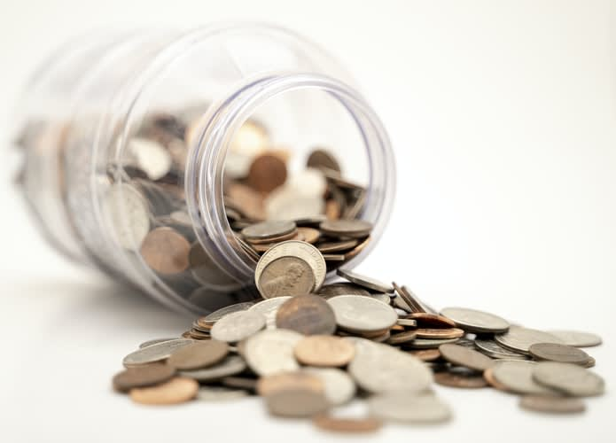 Upturned jar with money spilling out