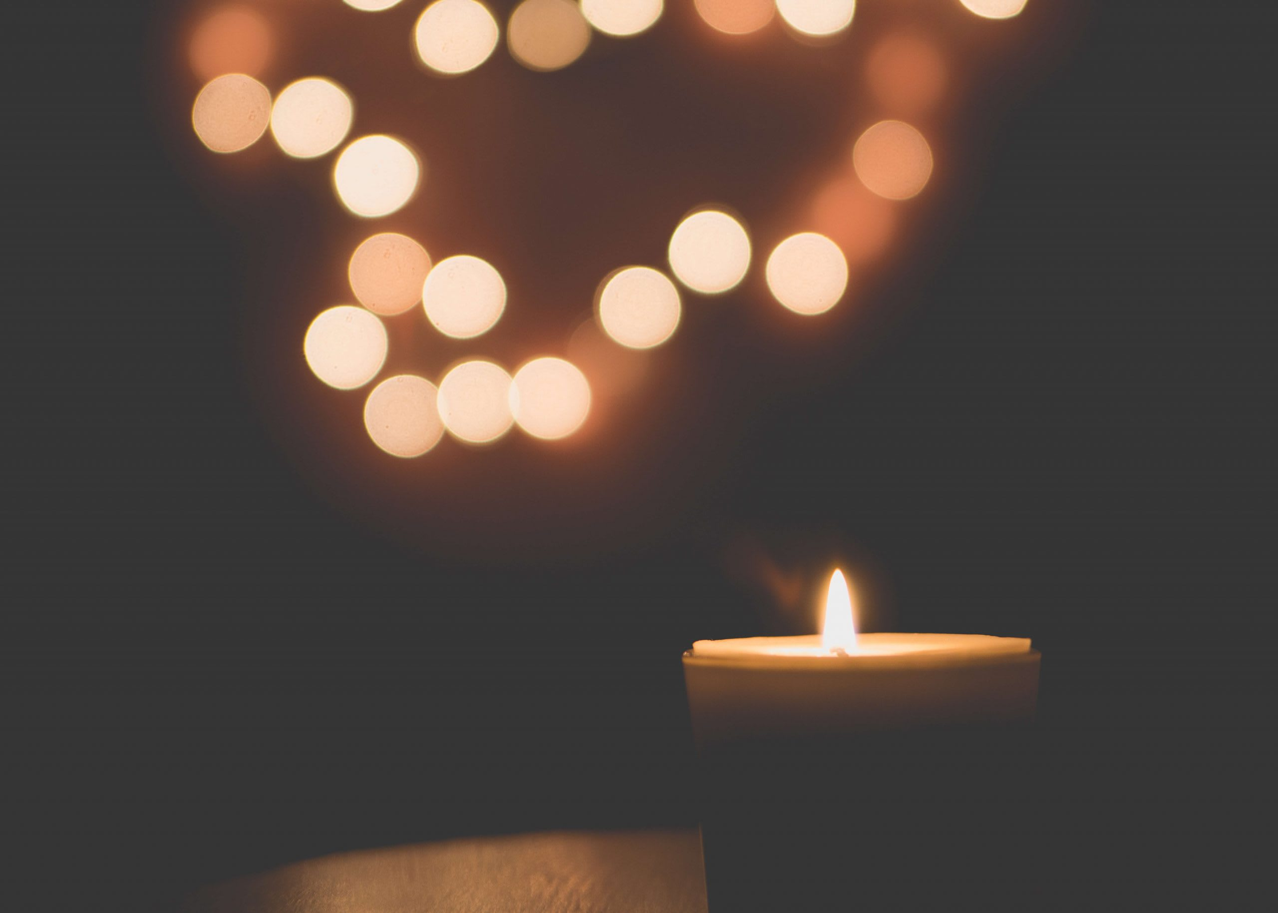 A lit candle can help you remember a loved one at Christmas