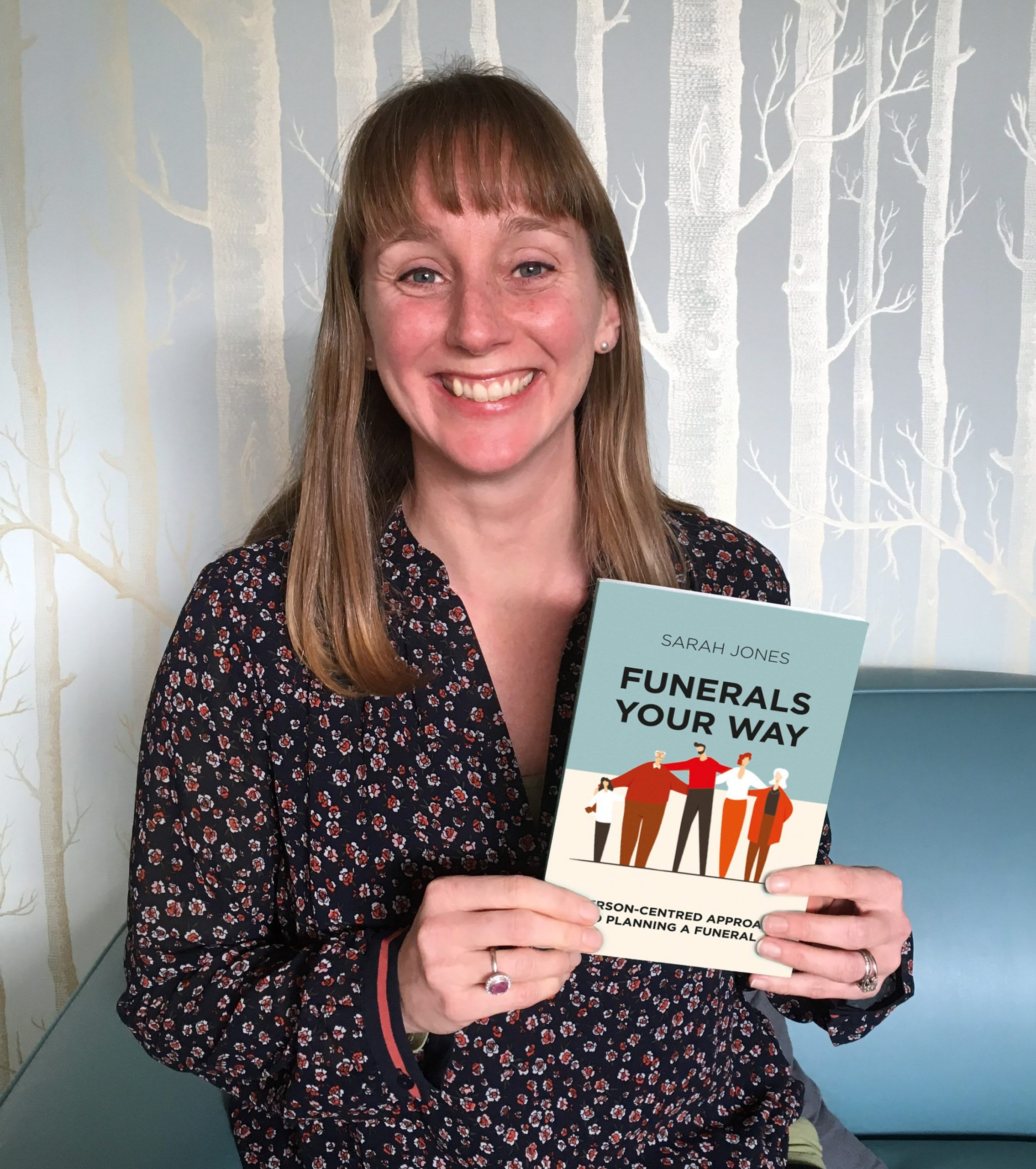 Sarah Jones from Full Circle Funerals holds her book, Funerals, Your Way