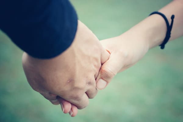 Do you need a will if you are married - man and woman holding hands