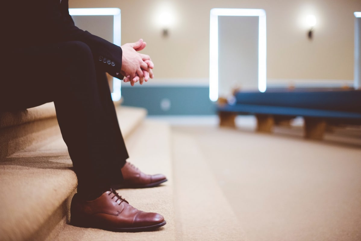 Man looking nervous in church