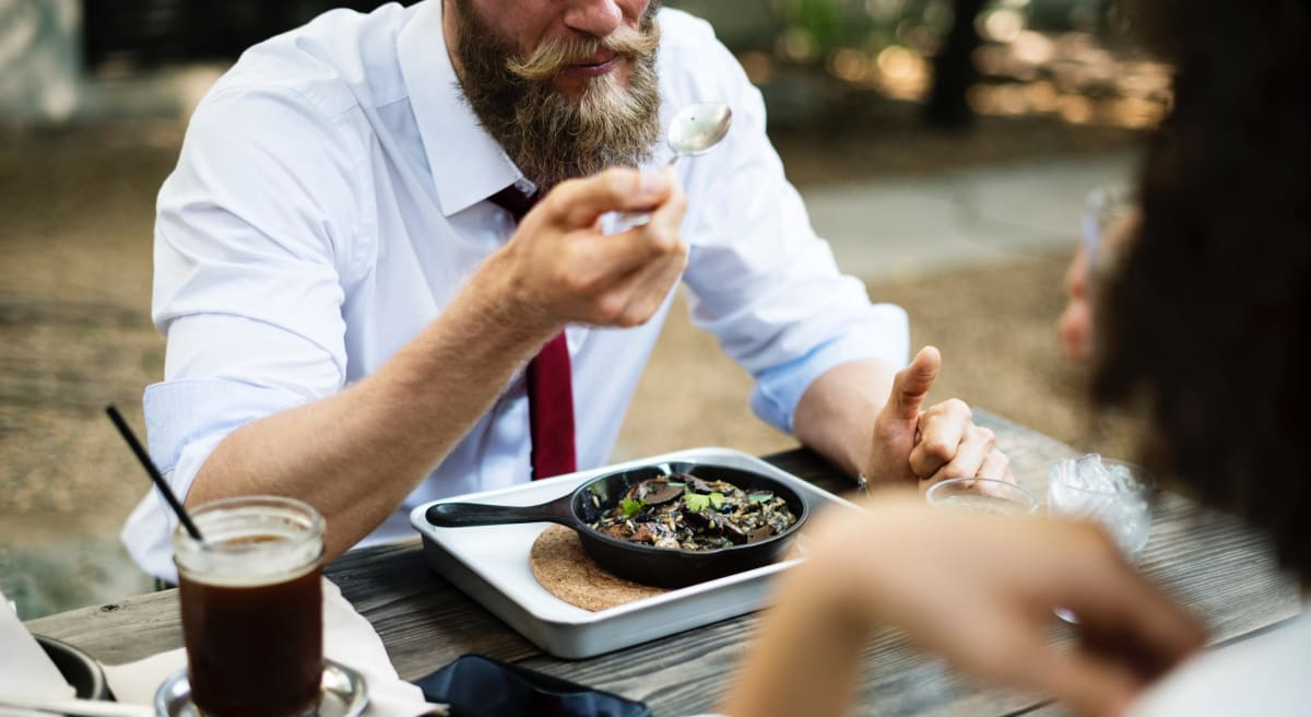 Man eating dinner and explaining why his moustache was worth being disinherited