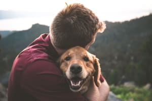 Man hugging his dog