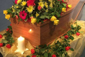 Coffin with candle set up by Go Simply Funerals