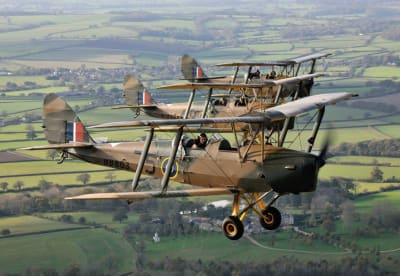 Ashes being scattered from a vintage wartime Tiger Moth