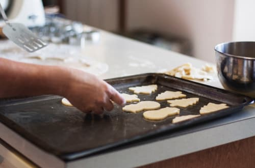 Keeping busy doing something like cooking biscuits can help you cope with grief at Christmas