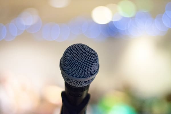 Eulogy examples: a microphone in front of a blurred background