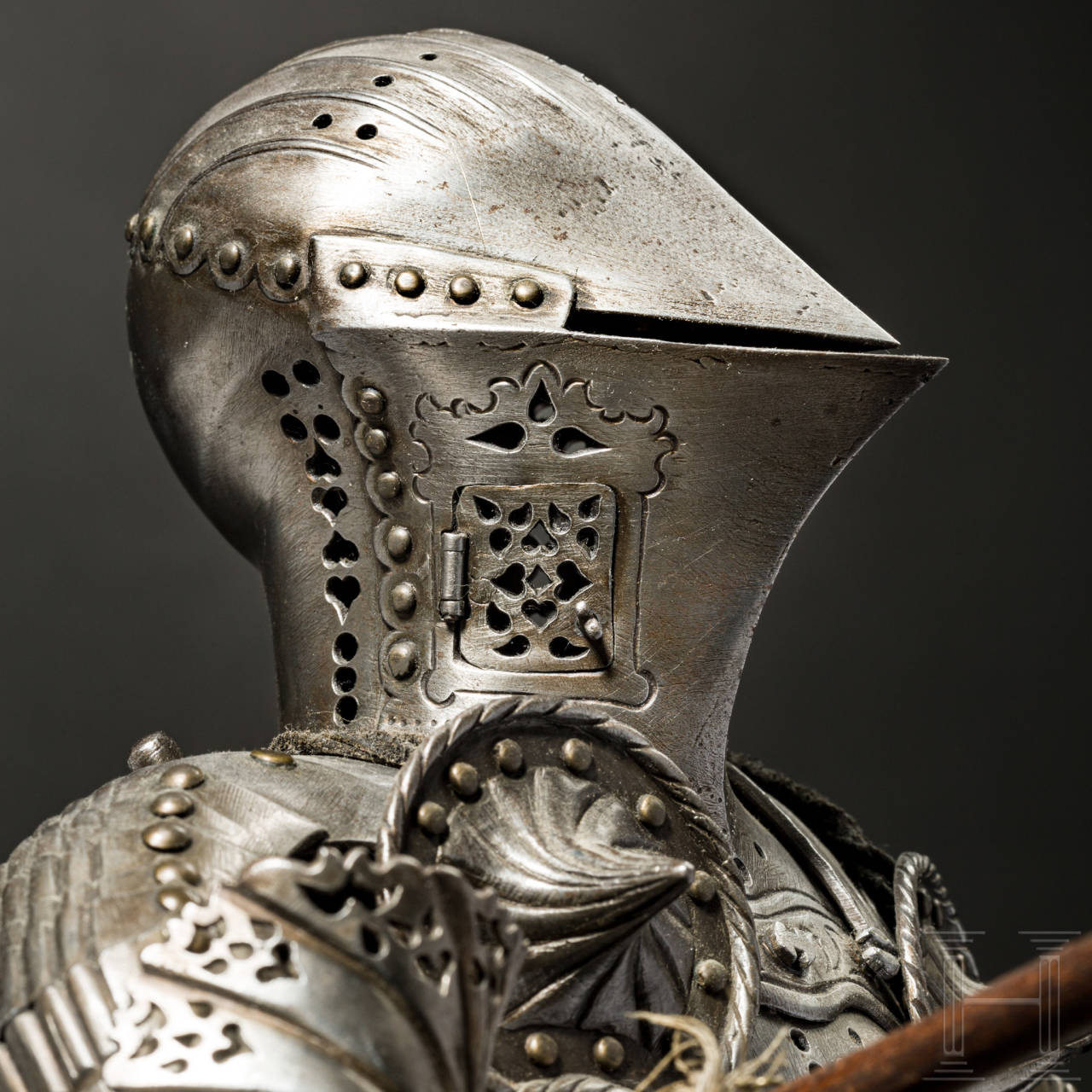 A miniature suit of jousting armour, made by the artisan smith Schneider of Munich before 1923