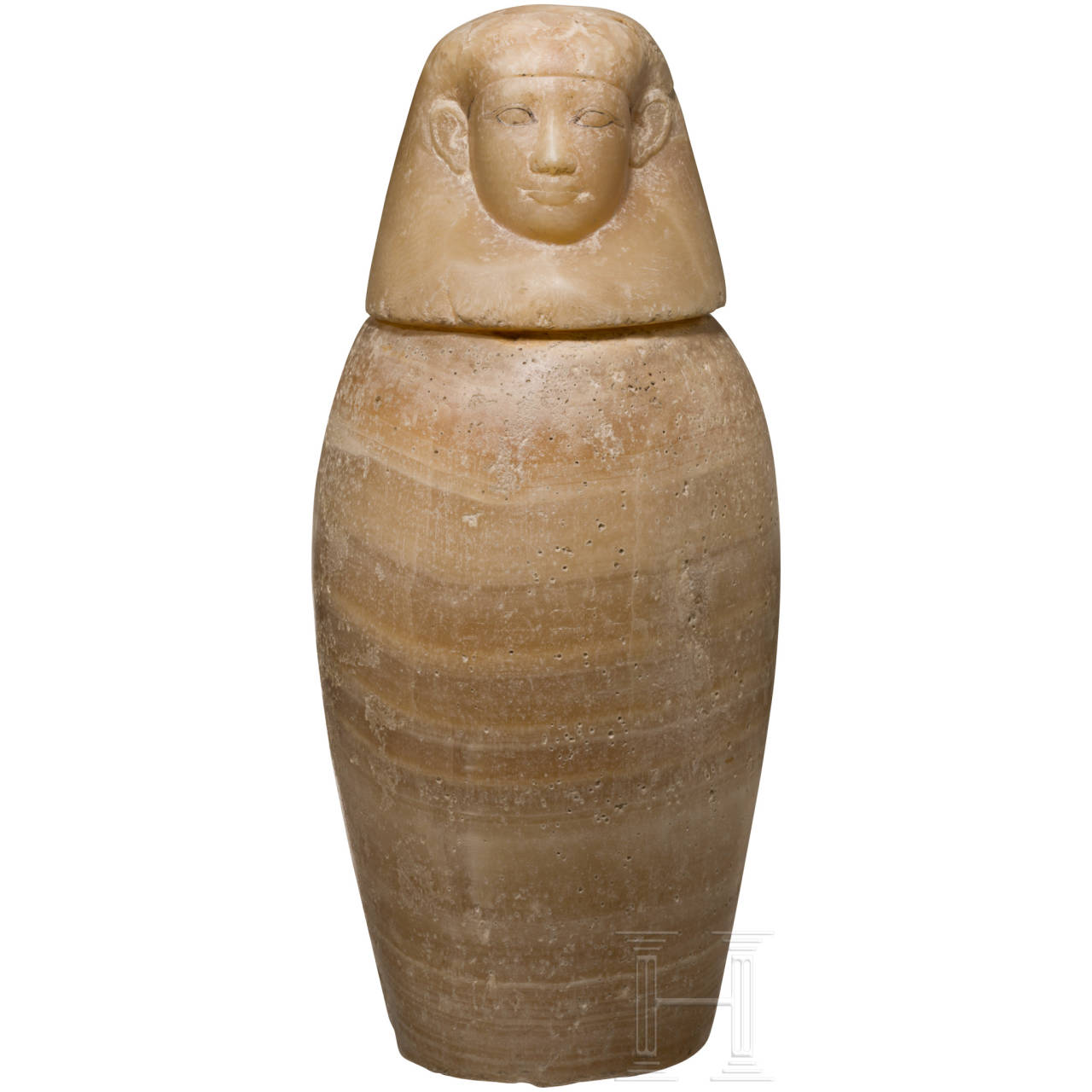 An Egyptian canopic jar with Imseti lid, 26th dynasty, 664 - 525 B.C.