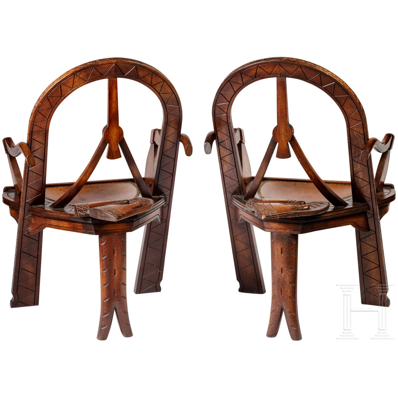 """Two carved armchairs in Russian style """"bow, axes and mittens"""", after the well-known model of carver Vasiliy Shutov, Russia, circa 1900"""
