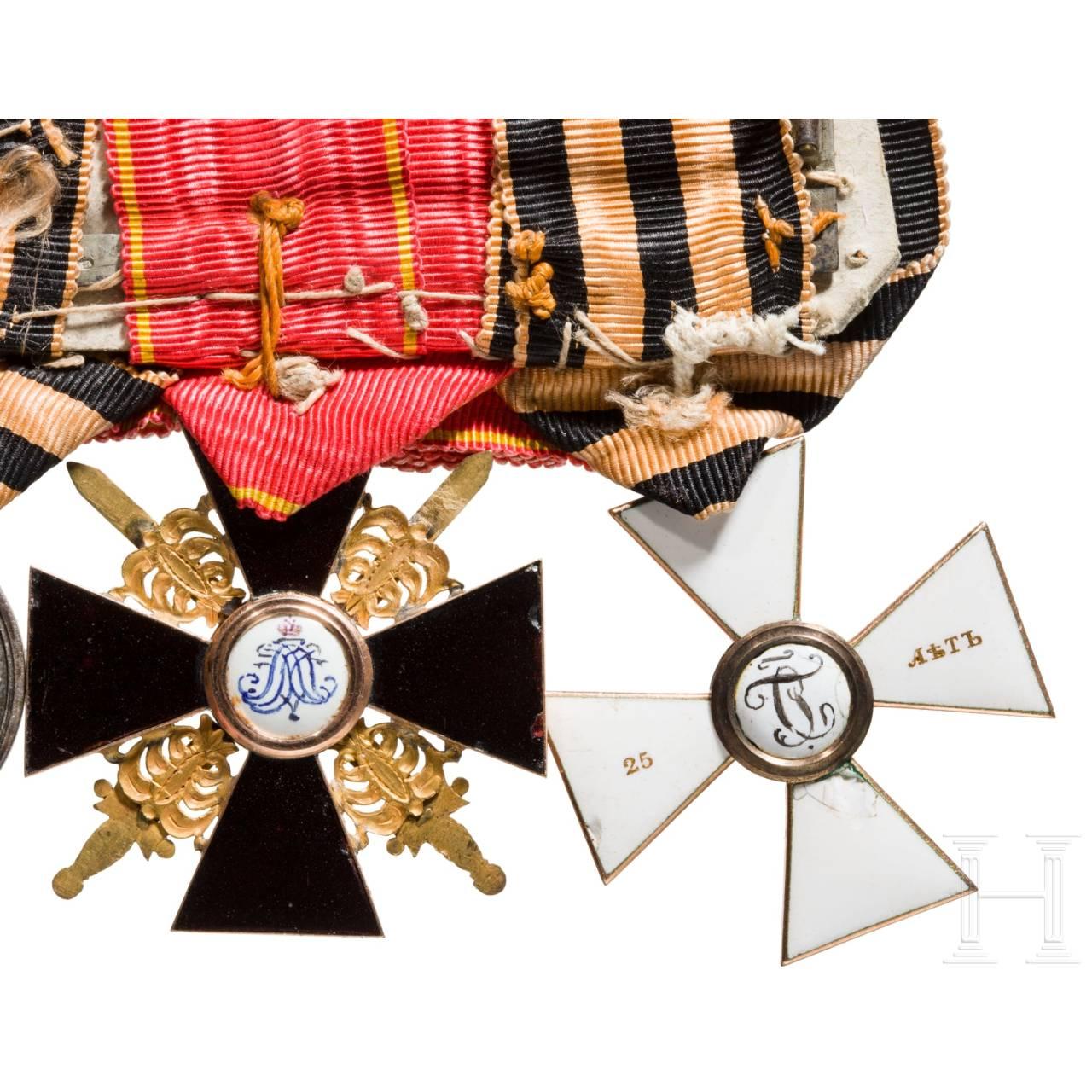 Seltene Ordensspange mit St. Georgs-Orden, Kreuz 4. Klasse für 25 Dienstjahre, St. Anna-Orden, Kreuz 3. Klasse mit Schwertern, Orden Virtuti Militari, Kreuz 4. Klasse, Russland, Mitte 19. Jhdt.