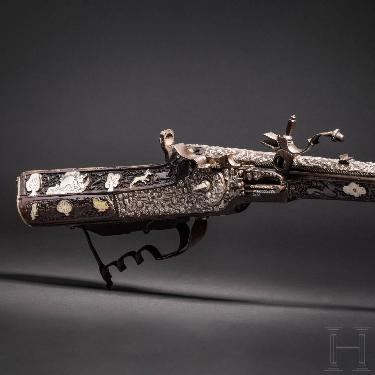"Emperor Ferdinand III of Austria – a deluxe wheellock rifle with silver and mother-of-pearl inlays, ""Master of the Animal-Head Scroll"", Vienna, circa 1650"