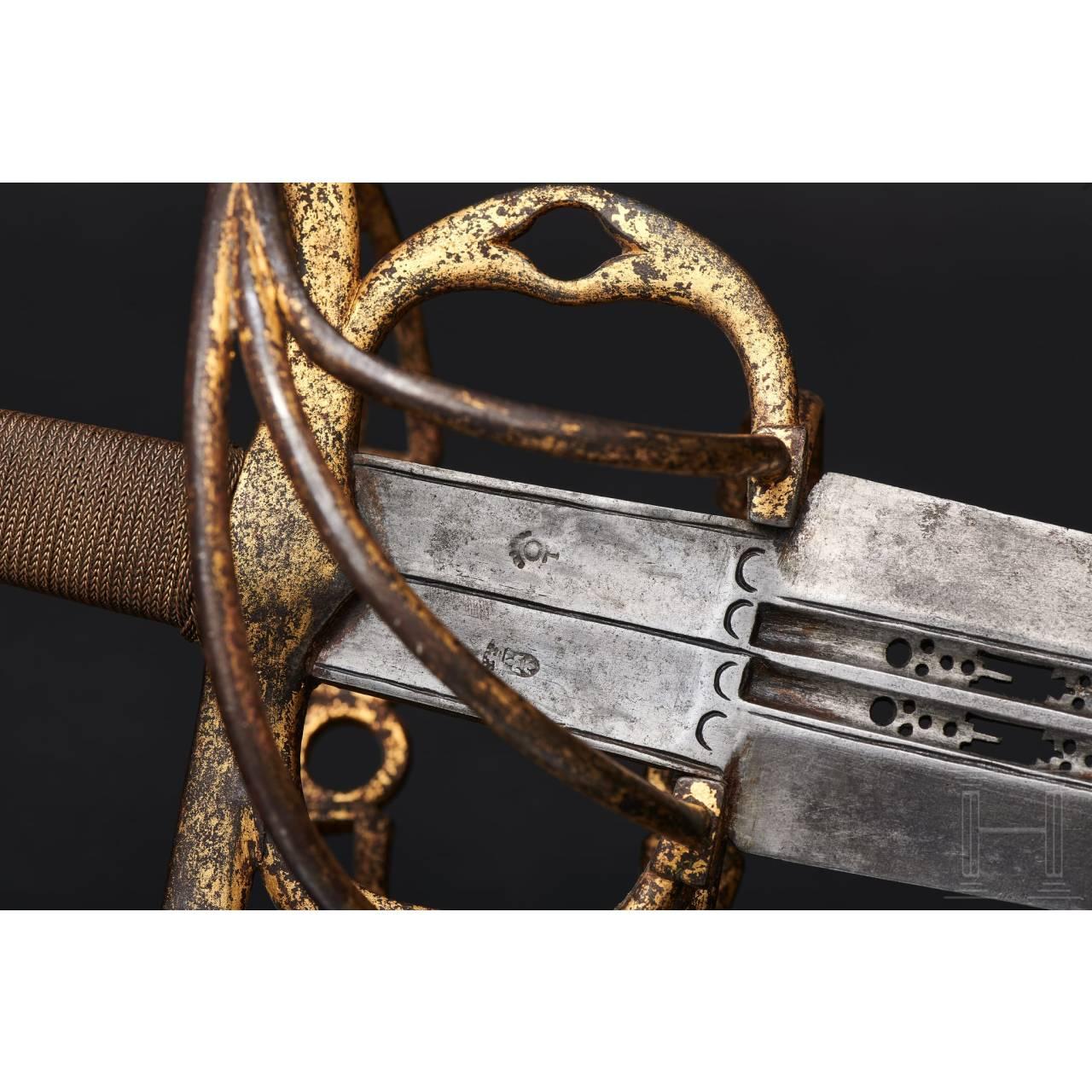A heavy Spanish sword with a gilt hilt, circa 1560