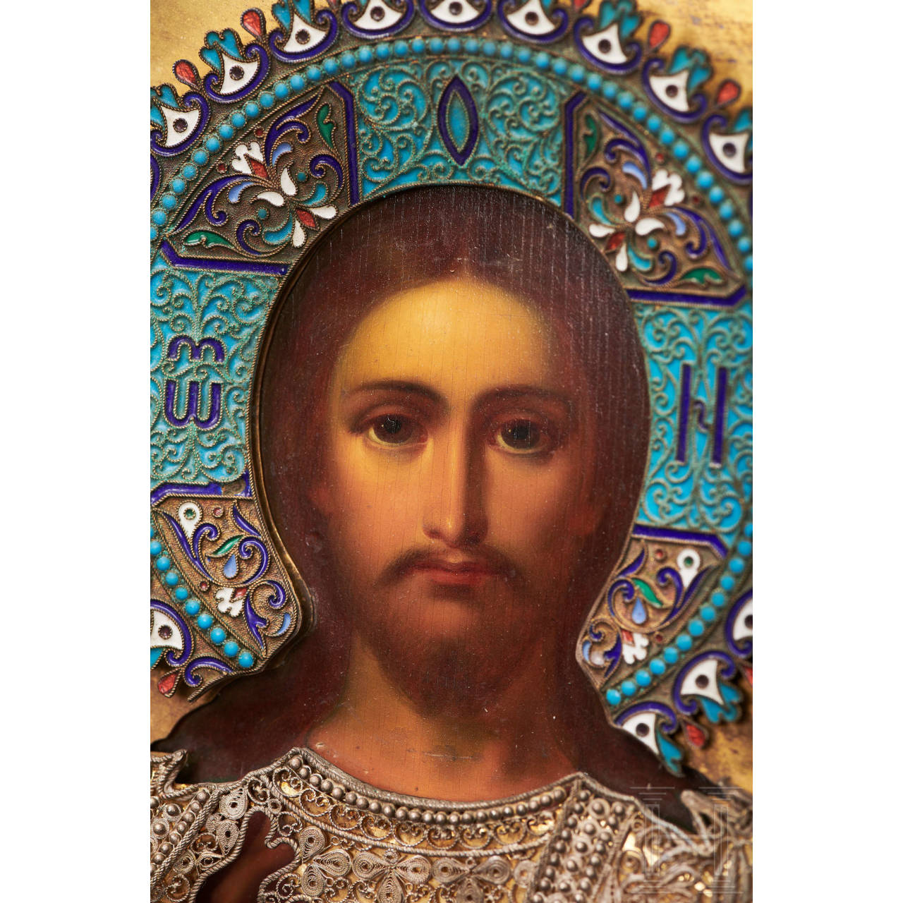 """A splendid Russian icon """"Christus Pantokrator"""" with silver and partly enamelled oklad, Moscow, dated 1895"""
