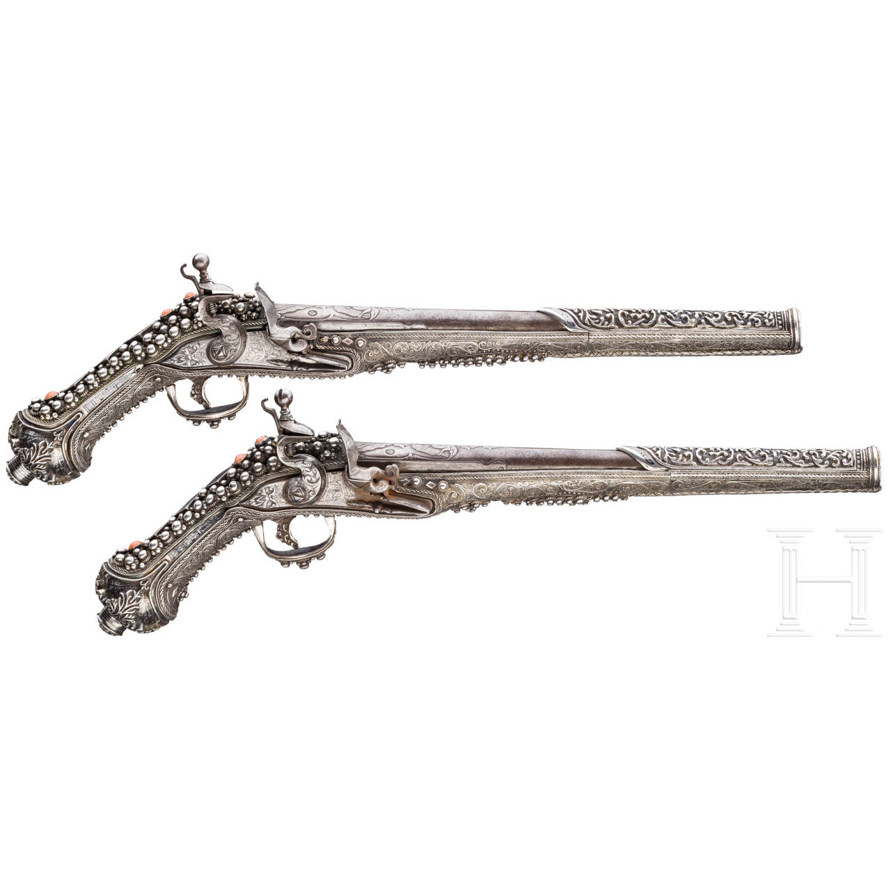 A magnificent pair of Balkan Turkish chiselled and silver-mounted flintlock pistols, 19th century