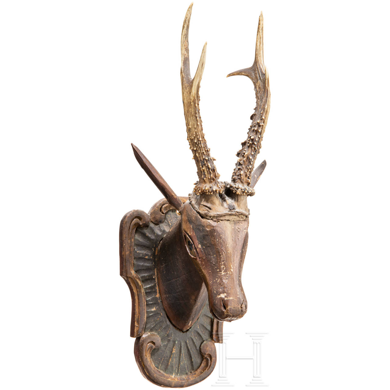 A roebuck trophy on a wood-carved plate, Southern German/Austrian, 19th century