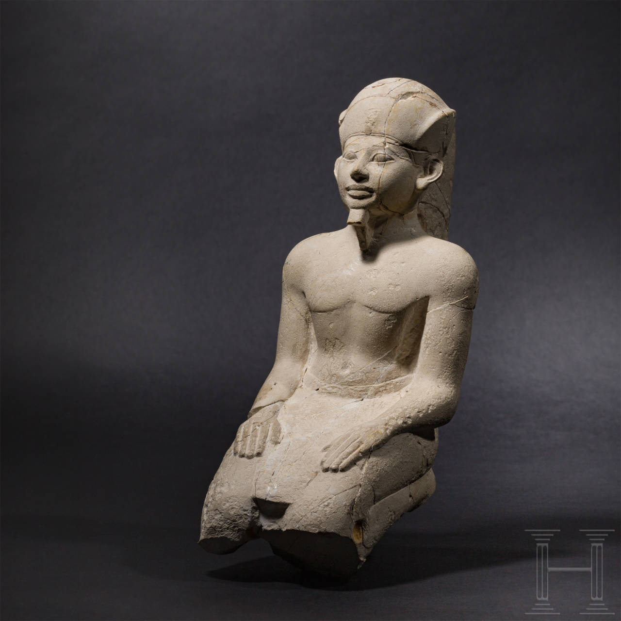 A kneeling limestone statue of a pharao, Late Period - Early Ptolemaic Period, 7th - 3rd century B.C.