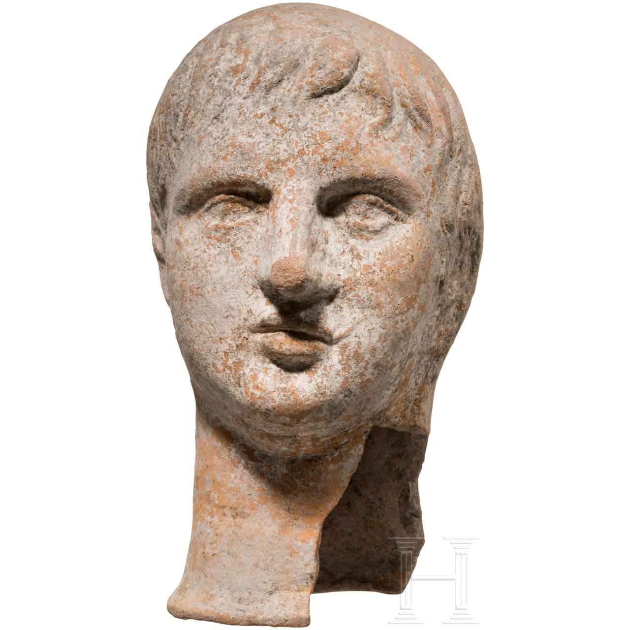 Etruskischer Votivkopf aus Ton, 3. - 2. Jhdt. v. Chr.