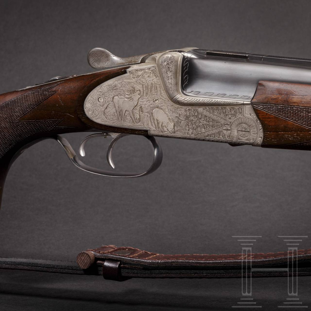An over and under Scheiring-Düsel combination rifle with insert barrel and Schmidt & Bender scope