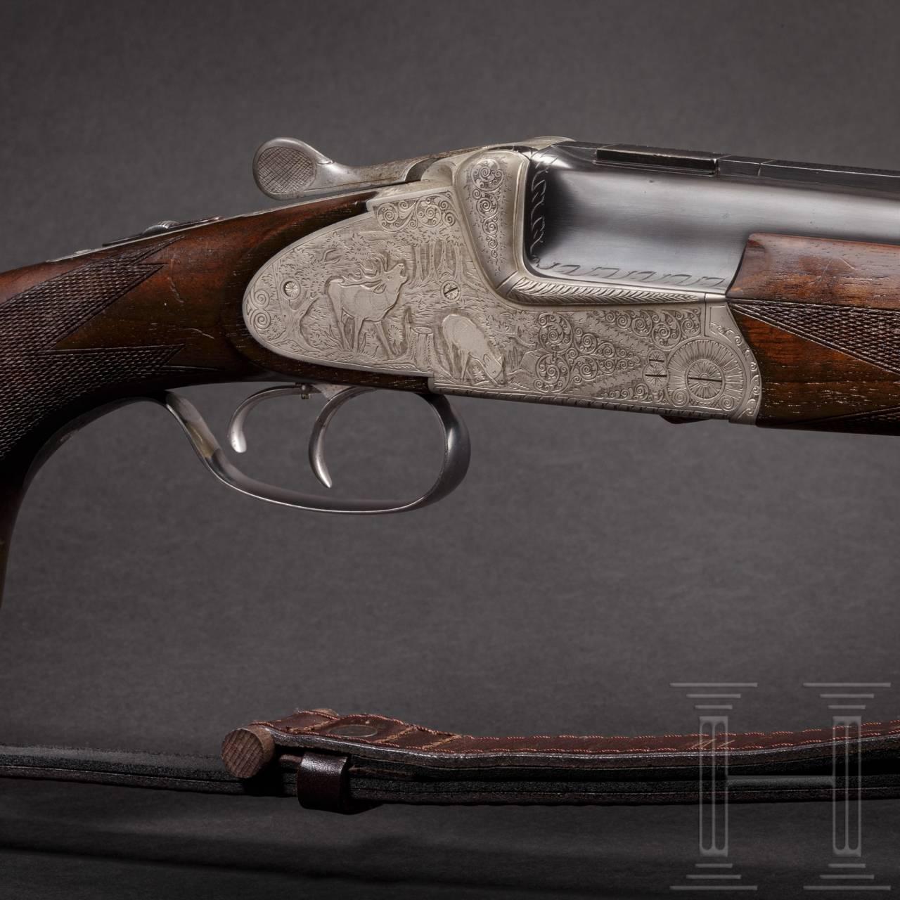 An over and under Scheiring-Düsel combination rifle with insert barrel and Schmidt & Bender scope