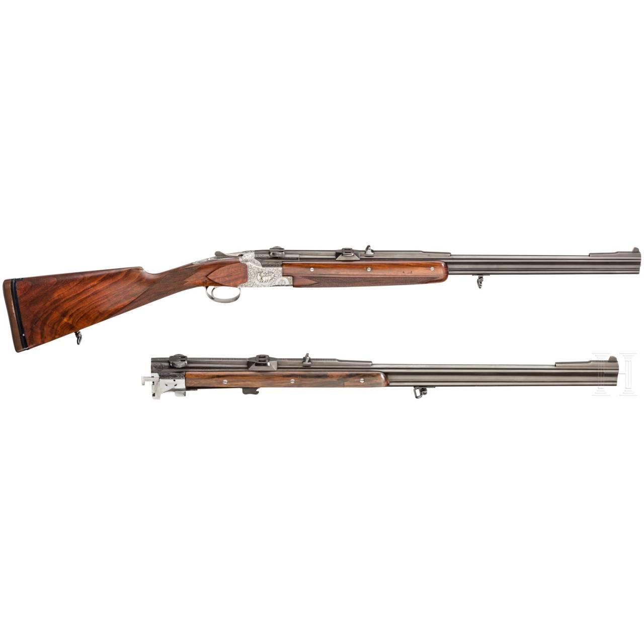 A cased O/U rifle FN Mod. Express with Hertel & Reuss scope and interchangeable O/U rifle barrel with Hertel & Reuss scope