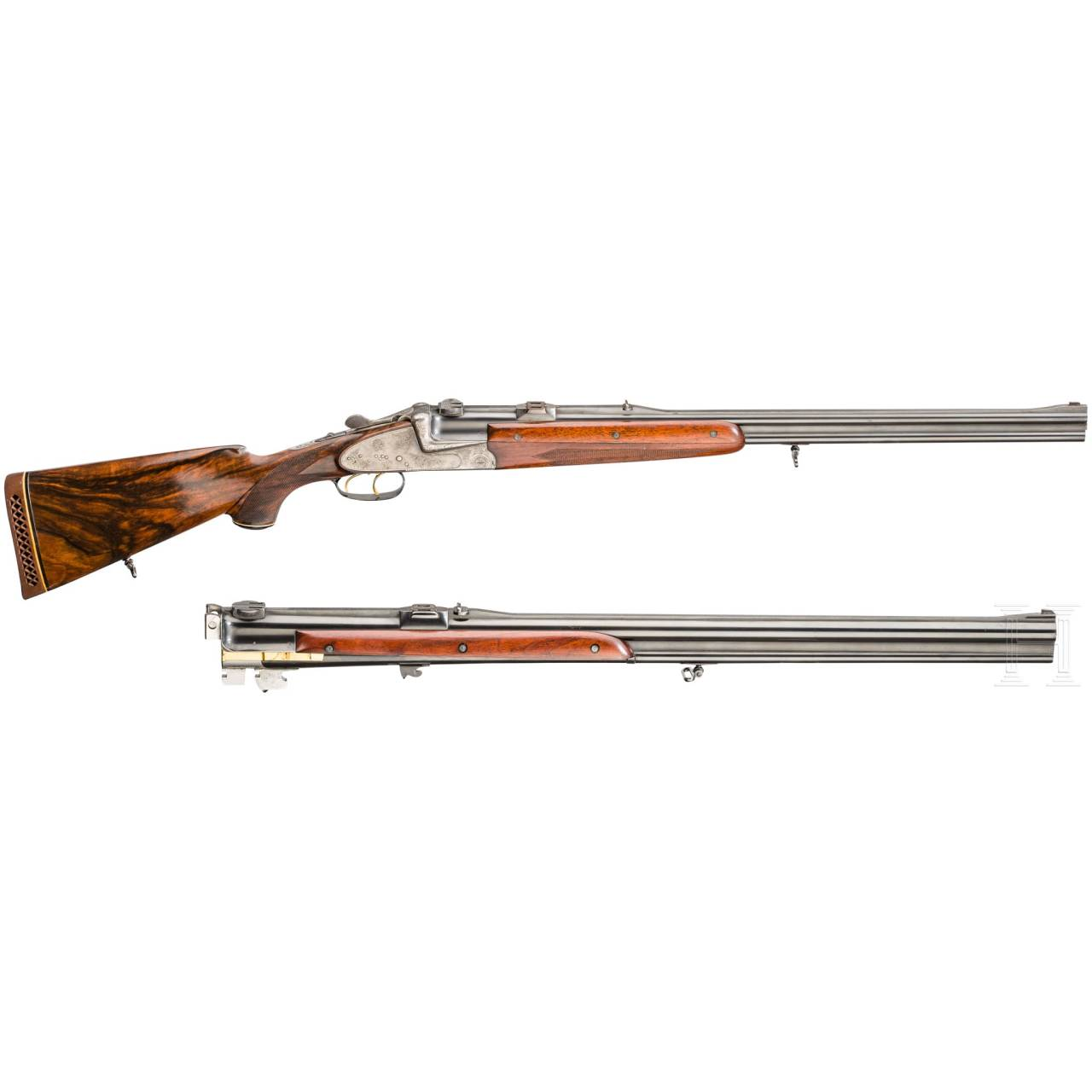 A cased O/U double rifle by Winkler, Ferlach, with Kahles scope and interchangeable O/U combination rifle with Hensoldt scope