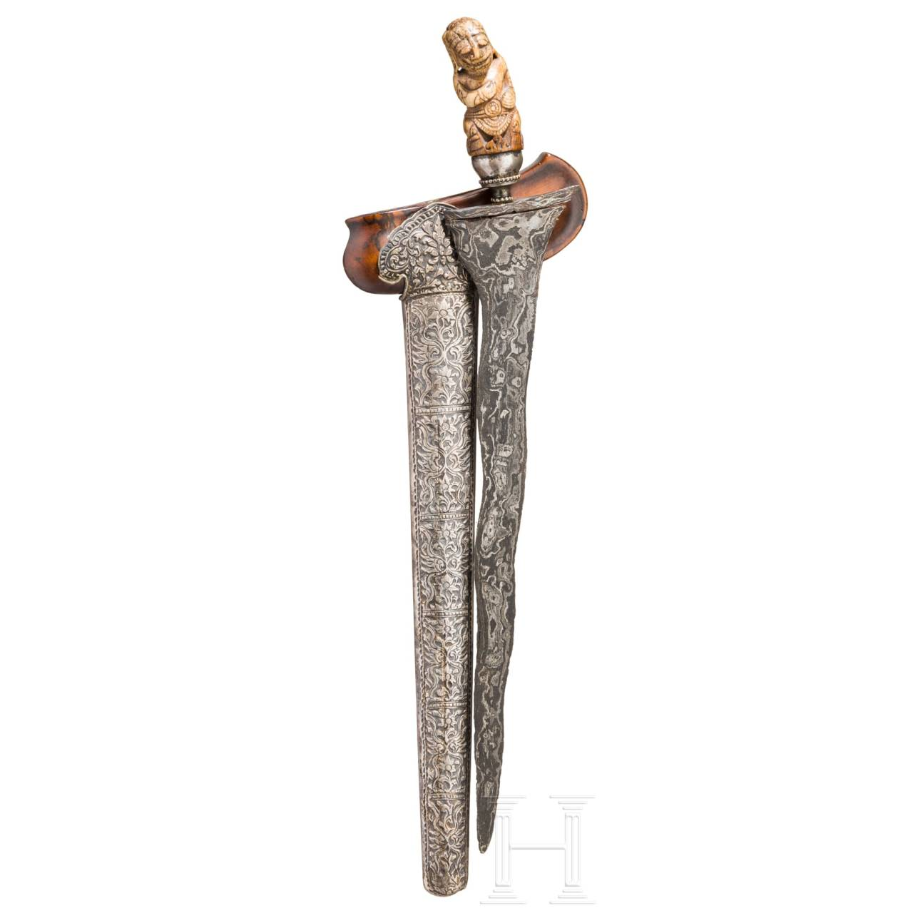 An early silver mounted Javanese Kris, the hilt 15th/16th century