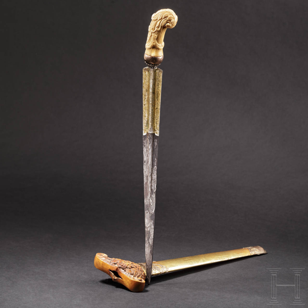 A fabulous, gold-mounted kris with an ivory grip that once belonged to a sultan of Mandura, circa 1900