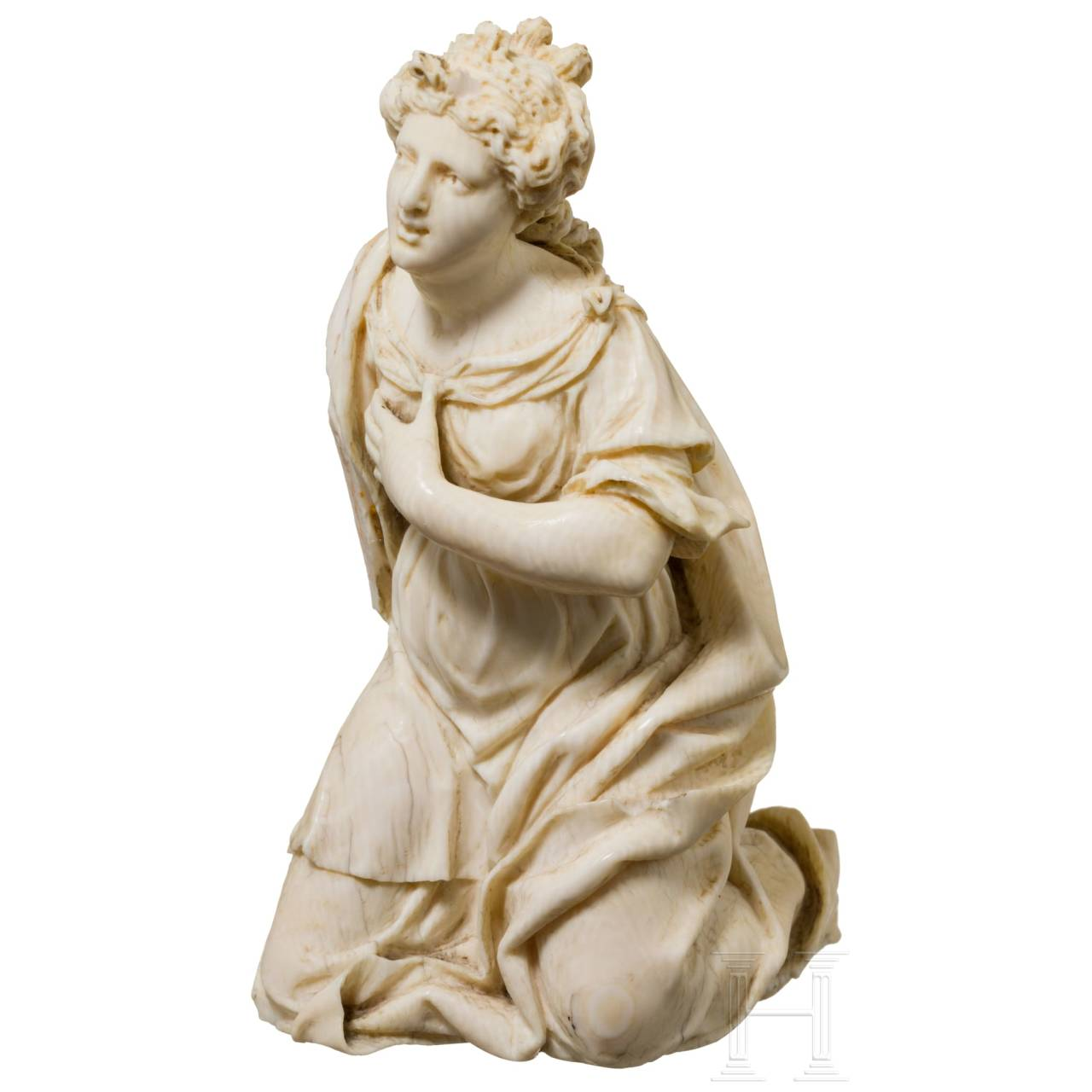 A Flemish carved ivory figurine of Mary Magdalene, 17th century