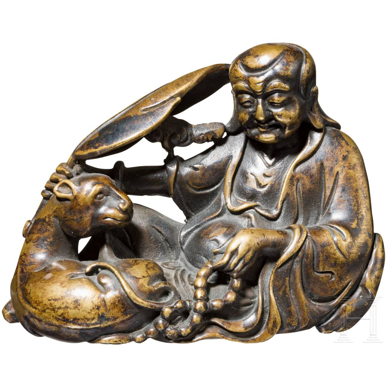 A small bronze of a resting wise man, China, 18th/19th century