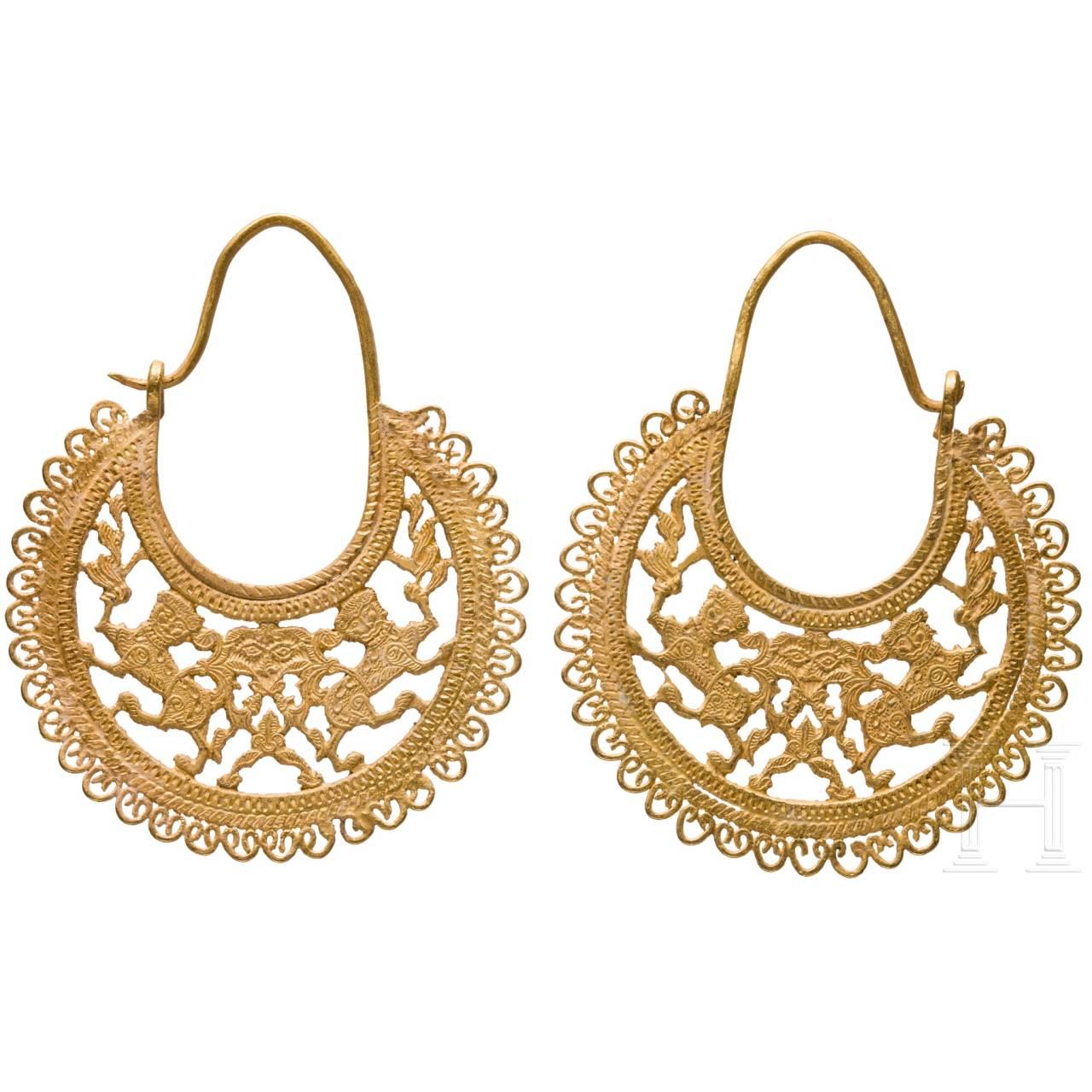 A pair of golden Seljuk earrings, 13th century