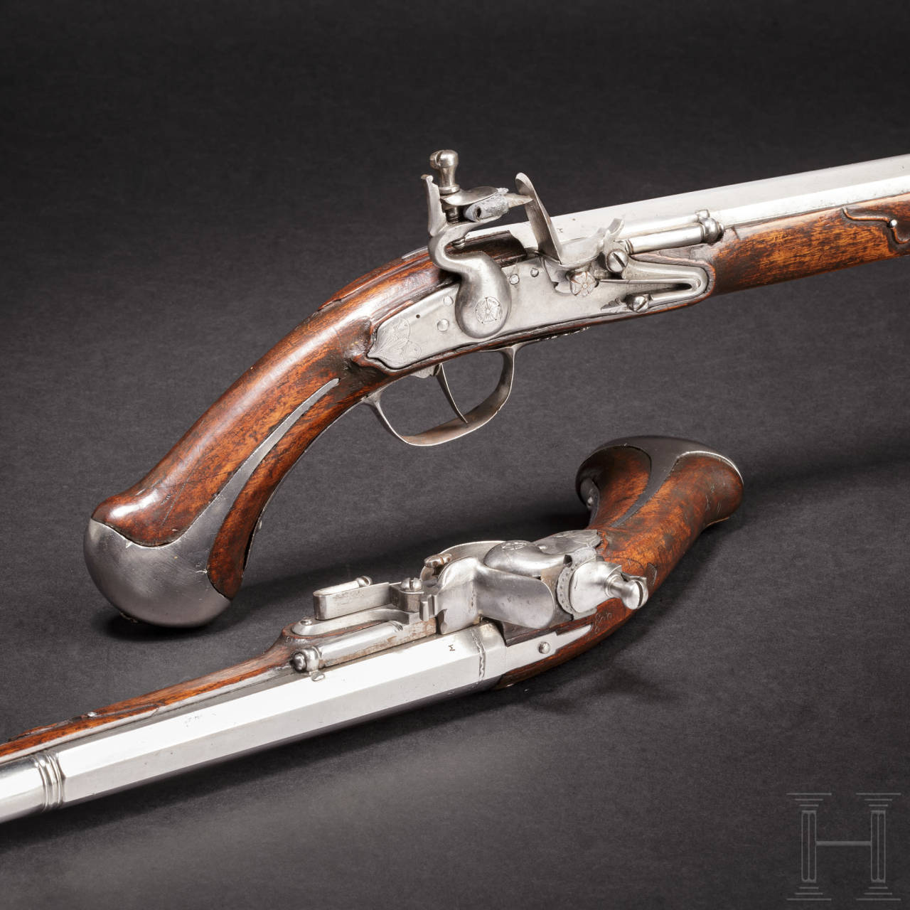 A rare pair of flintlock holster pistols made for superimposed loads, from the armoury of the Princes of Salm-Reifferscheidt-Dyck, northern German or Dutch, circa 1660