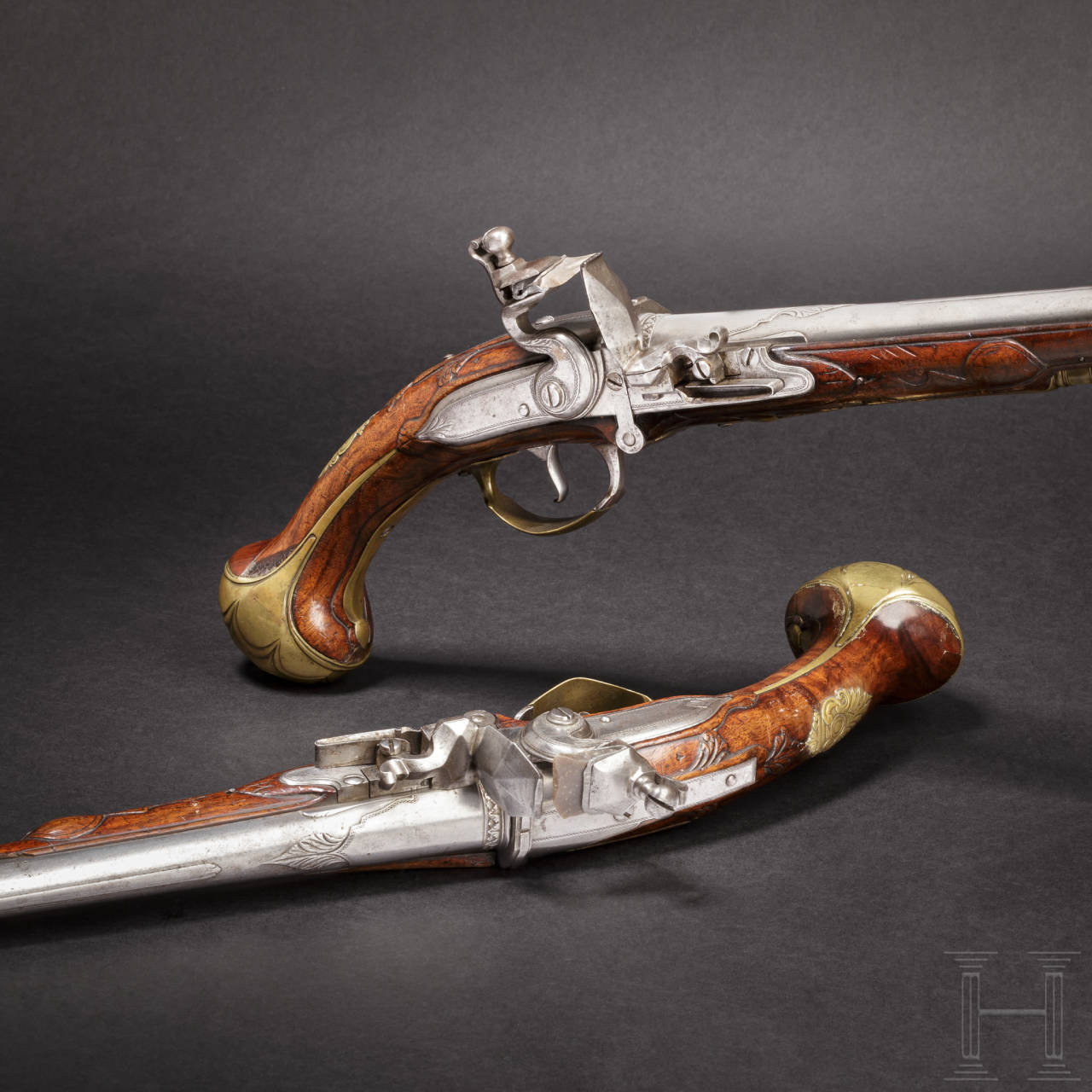 A pair of Flemish, long breechloading flintlock pistols, circa 1720/30