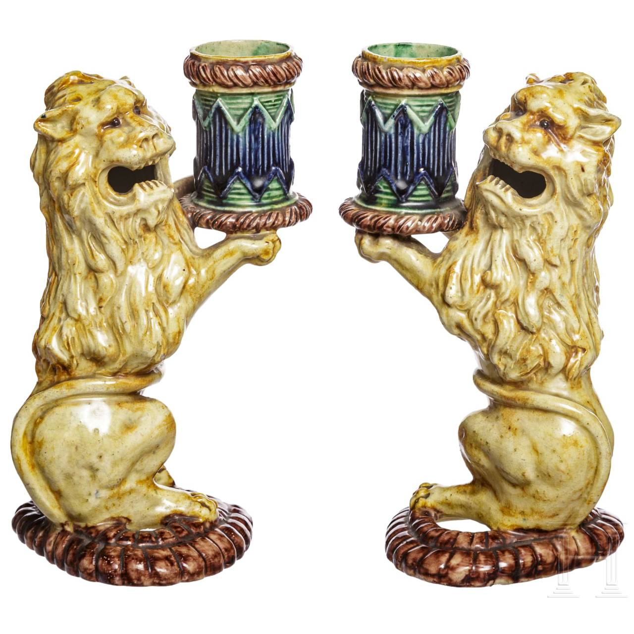 A pair of probably French Fayance lions as a candle holder, 19th century