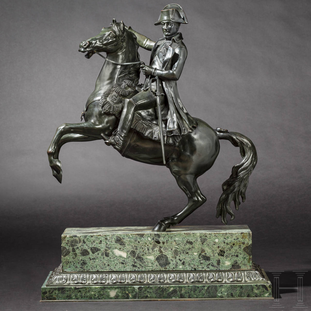 A monumental bronze figure of Emperor Napoleon I on a rampant horse