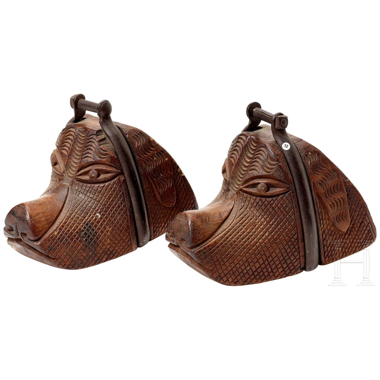 A pair of South American stirrups in the shape of a dog's head, 19th century