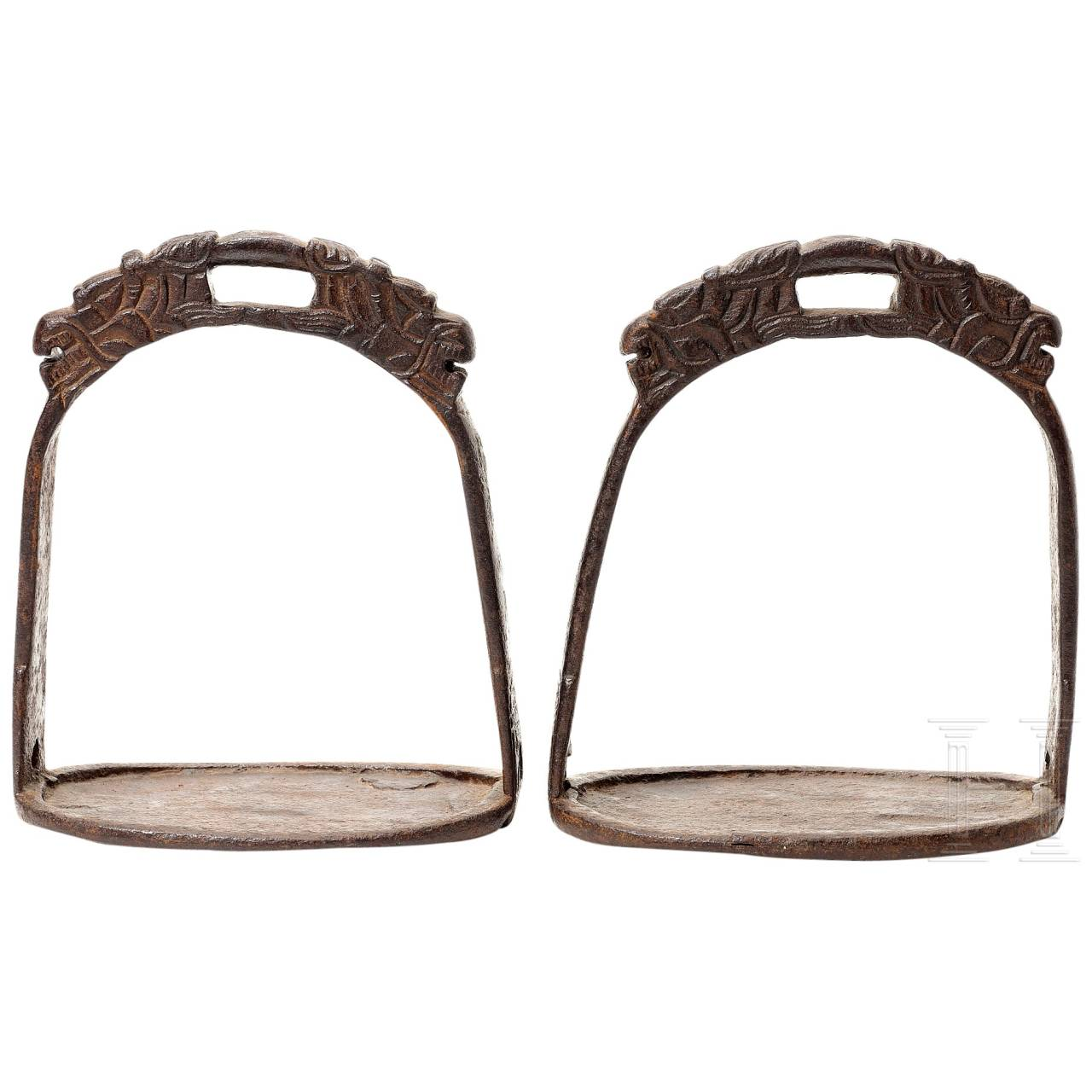 A pair of Chinese iron stirrups, 17th-18th century