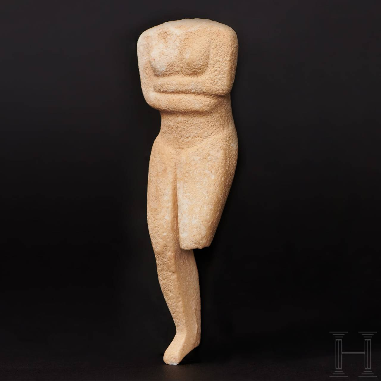 A Greek female marble Cycladic idol of the Kapsala type, circa mid 3rd millennium B.C.