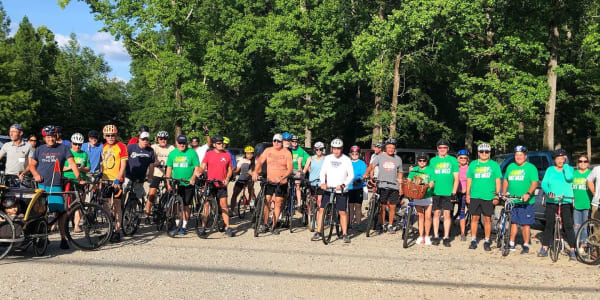 A group photo of bicycle riders.