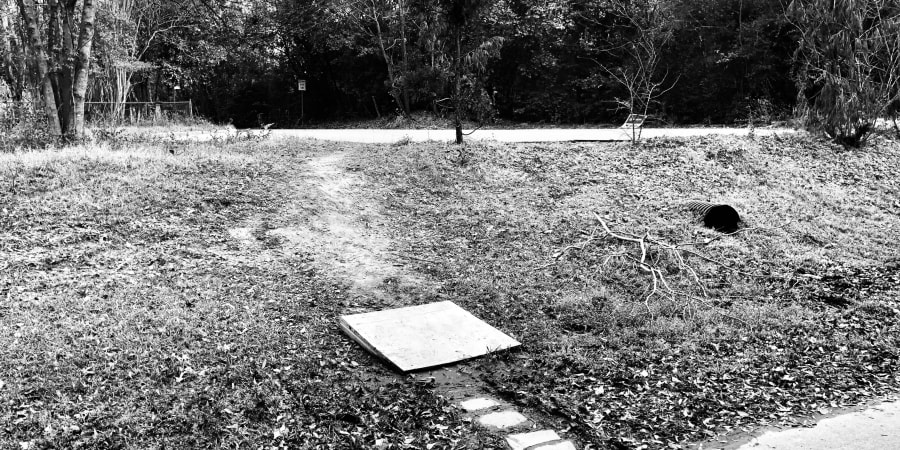 """A black-and-white photograph of a """"demand trail."""""""