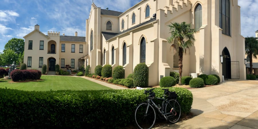 A photo of my bicycle in front of a church.