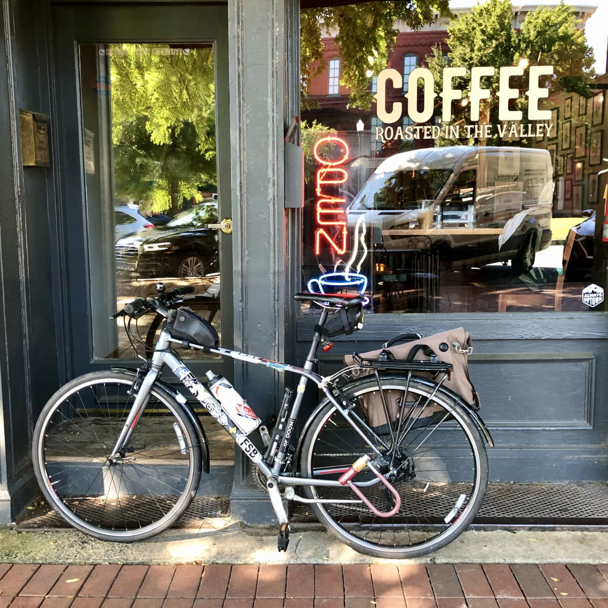 A photo of my bicycle in front of Fountain City Coffee.