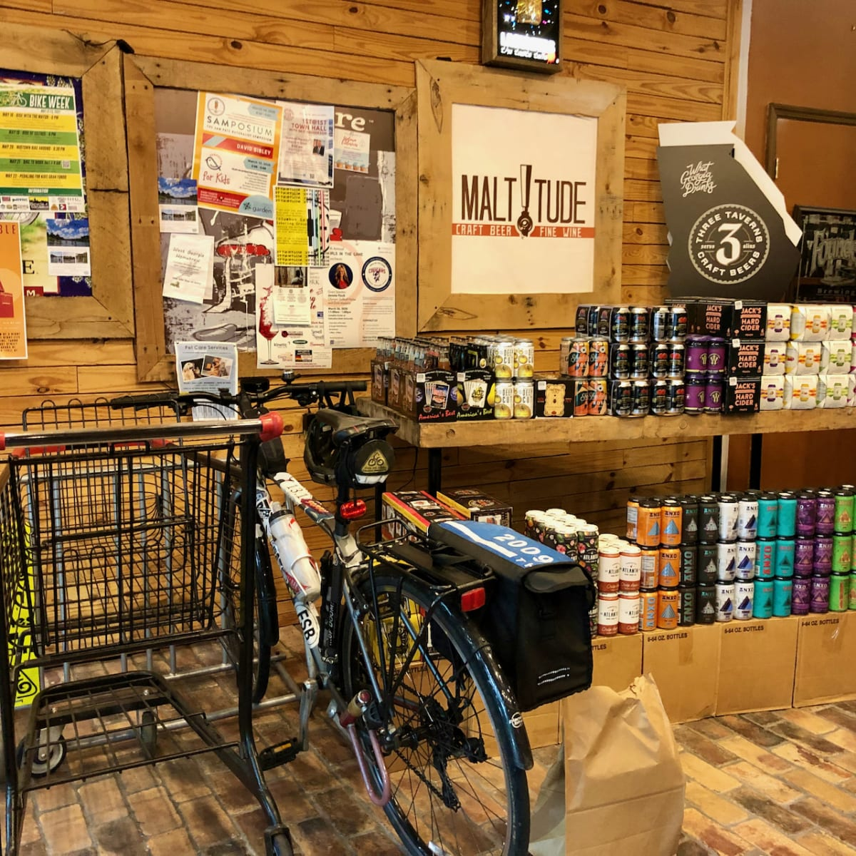 A photo of my bicycle parked inside the Maltitude store.