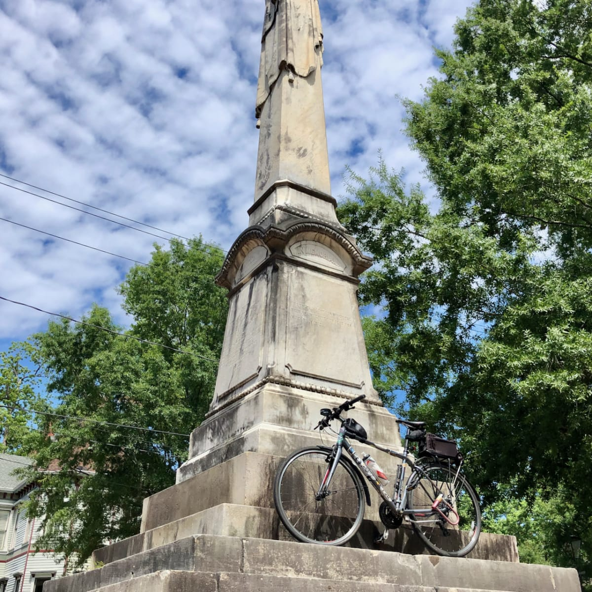 A photo of my bicycle in front of a monument.