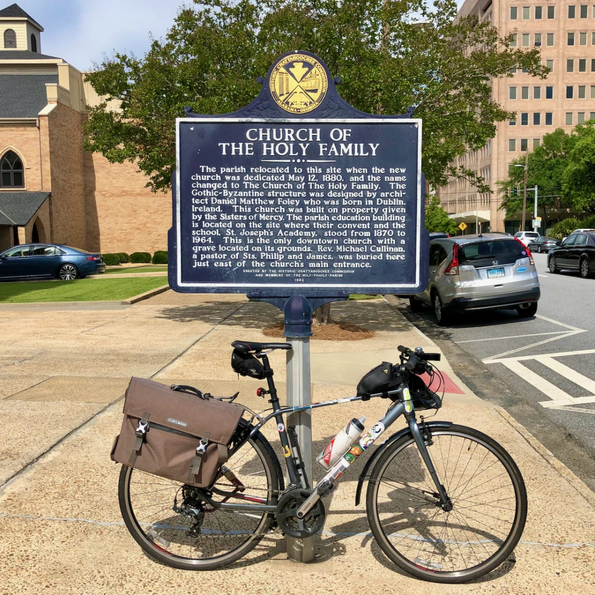 A photo of my bicycle in front of the church's historic marker.